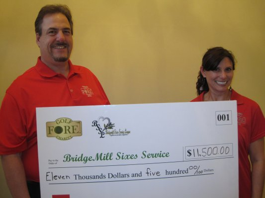 Jay & Suzanne with the BIG check